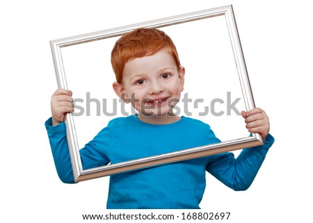 Boy holding picture frame - stock photo