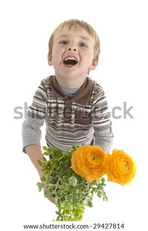 Boy holds flowers out.  Mother's day or spring theme - stock photo