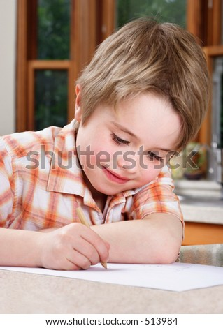 Boy homework/drawing - stock photo