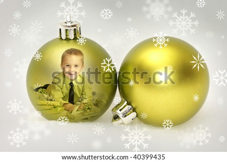 boy in a bauble with snowflakes - stock photo