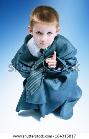 Boy in a business suit with his father expressive facial expressions - stock photo