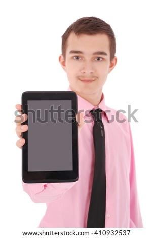 Boy in a pink shirt hold a tablet PC isolated on white. Shallow depth focus on tablet PC - stock photo