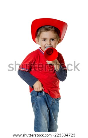 Boy in a red helmet with a horn of fire in his hands shouting isolated on white background - stock photo