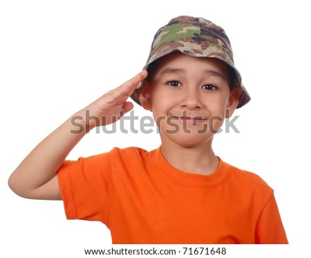 boy in camouflage hat and orange shirt saluting, isolated on white - stock photo