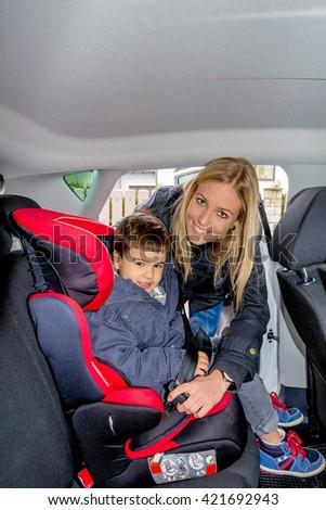 boy in car seat - stock photo
