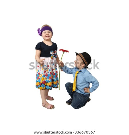 Boy in country style festive clothes kneeling gifts flower to girl with proud facial expression isolated on white background in square - stock photo