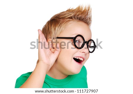 Boy in green shirt  listening to the rumors - stock photo