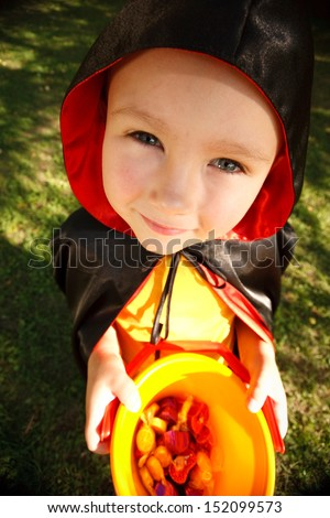 Boy in halloween costume trick or treating. Shot with wide-angle lens effect - stock photo