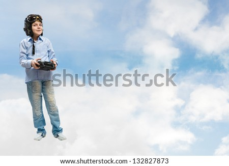 Boy in helmet pilot radio remote control with the game - stock photo