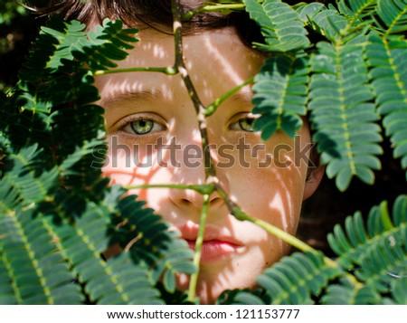 Boy In Hiding - stock photo