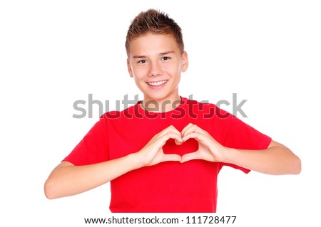 Boy in red tshirt making heart symbol with hands - stock photo