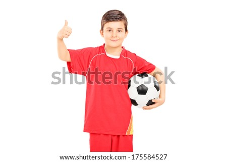 Boy in sportswear holding a football and giving thumb up isolated on white background - stock photo