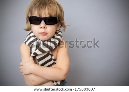 boy in sunglasses and striped scarf - stock photo