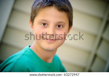 Boy in the green t-shirt - stock photo