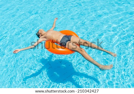 Boy in the pool. Photo for microstock - stock photo