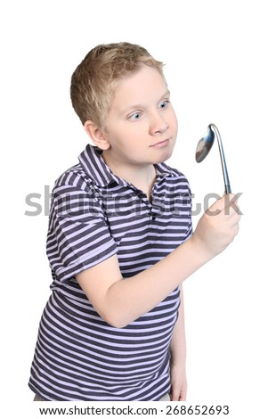 Boy is  bending spoon by concentration of mind force - stock photo