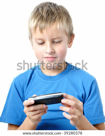 boy is browsing the snapshots on mobile phone - stock photo