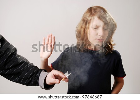 boy is disgusted by the smoke of a cigarette - stock photo