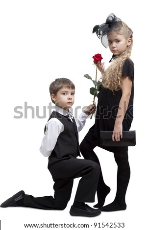 Boy is giving a rose to little girl, isolated on a white background. - stock photo