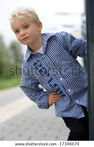 Boy is looking for the train - stock photo
