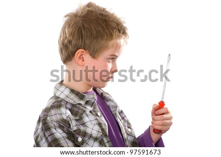 boy is looking skeptical on his turnscrew - stock photo