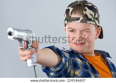 boy is playing shooting-game - stock photo