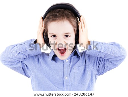 boy is screaming when is listening to music by headphones - stock photo