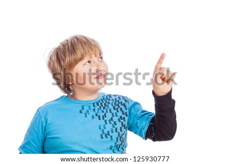 boy isolated on white pointing with his finger with space for custom text or a symbol - stock photo