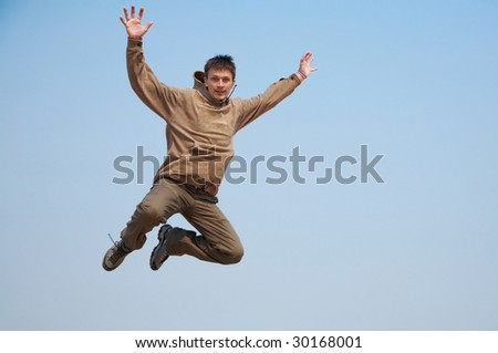 Boy jumping over the sky - stock photo