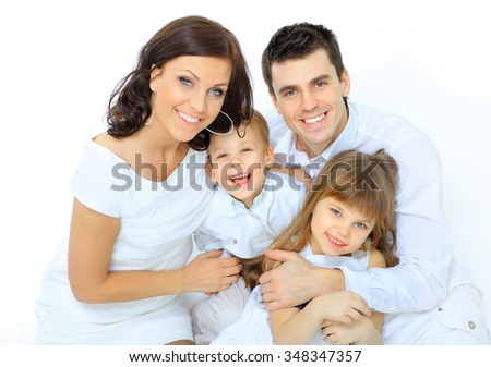 boy laughs with family - stock photo