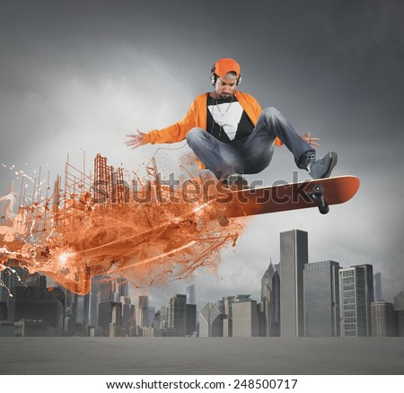 Boy leaves trail of fire with skate - stock photo