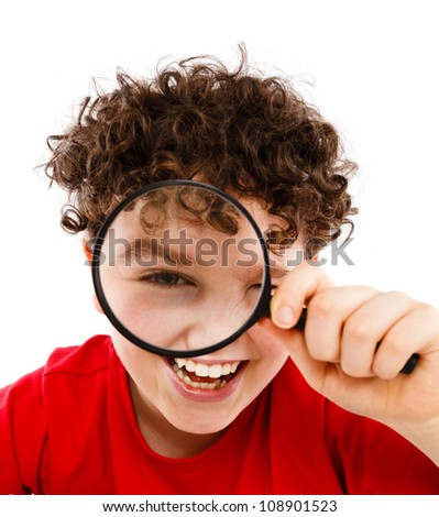 Boy looking through magnifying glass isolated on white - stock photo