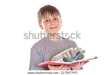 boy looks at a book on a white background - stock photo