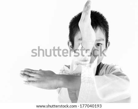 Boy Lying On Bed with victory fingers, black and white - stock photo