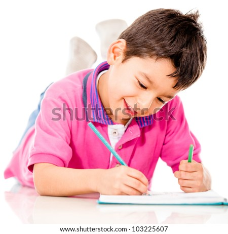 Boy lying on the floor coloring - isolated over a white background - stock photo