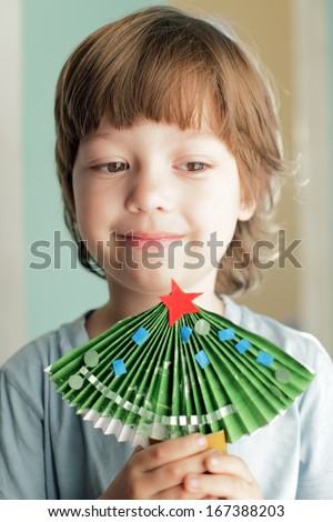 boy made of paper  christmas tree - stock photo
