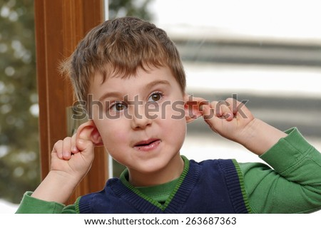 Boy making faces - stock photo