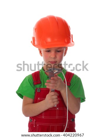 Boy measuring electrical cable with a caliper isolated on white - stock photo