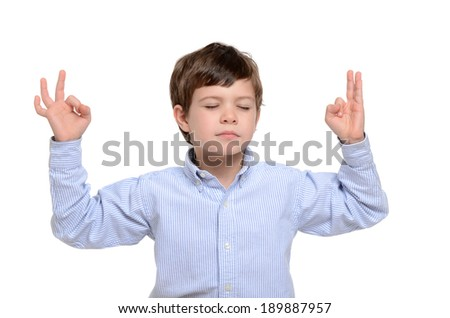boy meditating pose isolated white background - stock photo