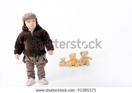 boy near his toys - stock photo