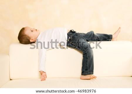 Boy on a sofa - stock photo