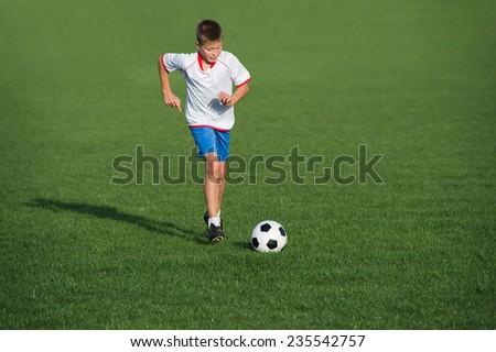 Boy on the football field - stock photo