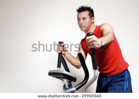 Boy on training apparatus in sportclub - stock photo