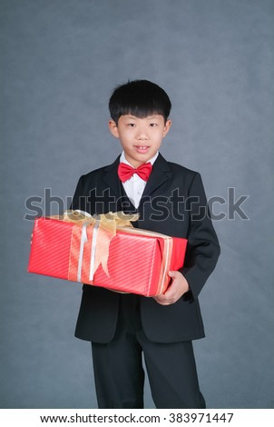 boy or asian chinese little boy with gift box on background - stock photo