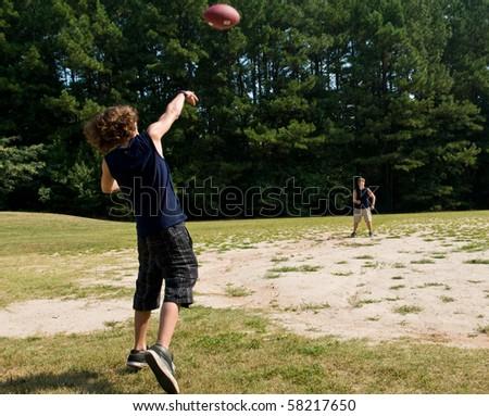 boy passing football - stock photo