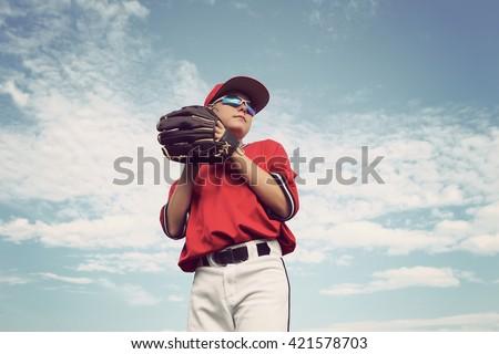 Boy pitching a baseball - stock photo