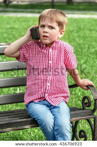 Boy plaing vith as he rolls talc and Eun Street and plaigrund vith and that radio, women outdoors, soft focus - stock photo