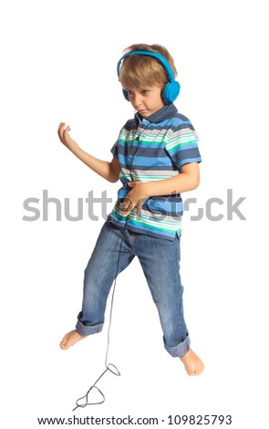 boy playing air guitar and dancing - stock photo