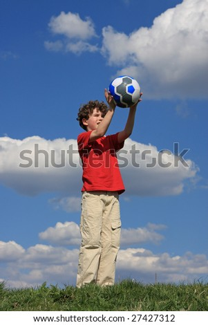 Boy playing ball outdoor - stock photo