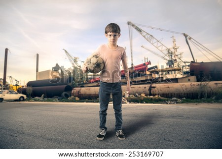 Boy playing football  - stock photo